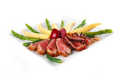 Roasted beef meat with corns Stock Photos