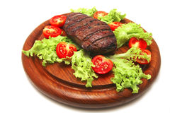 Roasted beef meat steak on wooden plate Stock Photo