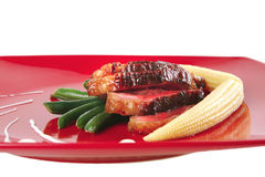 Roasted beef served with corns Royalty Free Stock Photos