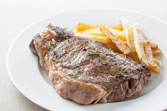 Roasted beef steak with fries Royalty Free Stock Image