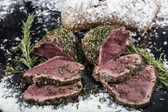 Roasted Beef steak with salt pepper thyme on rustic wooden table stock photos
