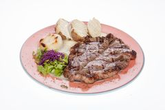 Roasted beef steak with steamed potatoes and salad. On white background Royalty Free Stock Photo