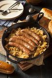 Roasted Beer Bratwurst with Saurkraut Stock Photo