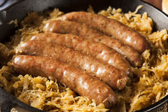 Roasted Beer Bratwurst with Saurkraut Stock Photos