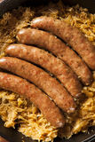 Roasted Beer Bratwurst with Saurkraut Royalty Free Stock Photography