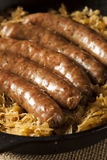 Roasted Beer Bratwurst with Saurkraut Royalty Free Stock Photos