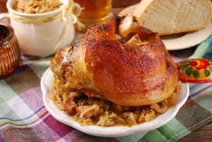 Roasted in beer pork knuckle with sauerkraut for dinner Stock Photography