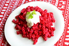 Roasted beet pasta. Deep purple-red beets Stock Image