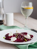 Roasted beet salad with goat cheese, olive oil and sesame seeds Stock Image