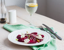 Roasted beet salad with goat cheese, olive oil and sesame seeds Stock Photography