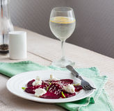 Roasted beet salad with goat cheese, olive oil and sesame seeds Stock Photos
