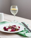 Roasted beet salad with goat cheese, olive oil and sesame seeds Stock Images