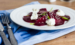 Roasted beet salad with goat cheese and sesame seeds, snack Stock Photo
