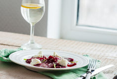 Roasted beet salad with goat cheese and sesame seeds, snack Stock Images