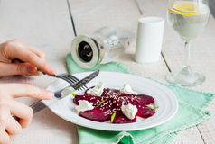 Roasted beet salad with goat cheese and sesame seeds, snack Stock Photography