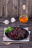 Roasted beetroot in black plate, close up Stock Images