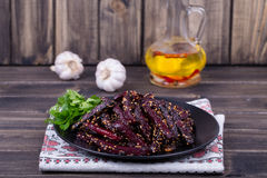 Roasted beetroot in black plate, close up Royalty Free Stock Photo