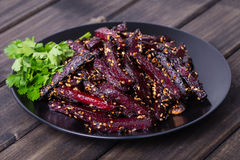 Roasted beetroot in black plate, close up Royalty Free Stock Image
