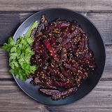 Roasted beetroot in black plate, close up Stock Photo