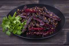 Roasted beetroot in black plate, close up Stock Photos