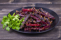 Roasted beetroot in black plate, close up Stock Image