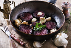 Roasted beetroot over rustic wooden background Royalty Free Stock Photography