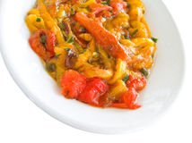 Roasted bell pepper salad on white dish. Stock Photography