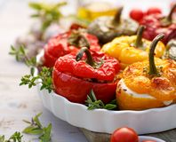 Roasted Bell Pepper With Mushroom, Rice, Cheese And Herbs Filling In A Baking Dish On A White Wooden Table, Close-up. Stock Image