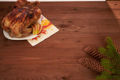 Roasted bird on a wooden table. Roasted bird on a brown wooden table stock photography