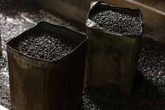Roasted black coffee beans buckets Royalty Free Stock Photos