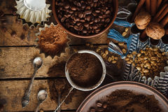 Roasted black and green coffee beans and ground coffee in the plate Stock Photography