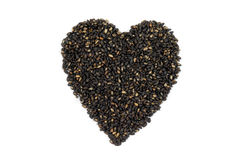 Roasted black sesame in heart shape Stock Images