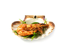 Roasted black tiger shrimp with salad, served in a scallop shell Stock Photo