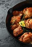 Roasted boneless skinless chicken thighs in lemon and thyme dressing served in vintage cast iron skillet, frying pan royalty free stock photo