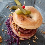 Roasted bratwurst in a bagel Stock Photos