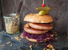 Roasted bratwurst in a bagel Royalty Free Stock Image