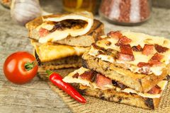 Roasted bread with egg omelet and chili pepper on a wooden table. Fastfood. Royalty Free Stock Photography
