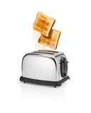 Roasted bread pops out from toaster. Royalty Free Stock Images