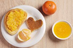 Roasted bread with tangerine jam and mandarin fruit royalty free stock photography
