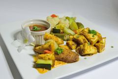 Roasted Breadfruit with steamed vegetables Stock Image