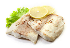 Roasted bream fish fillets on white background Royalty Free Stock Image