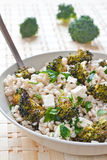 Roasted broccoli and farro salad with feta Stock Photo