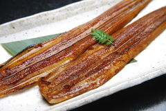 Roasted broiled eels stock image
