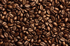 Roasted brown coffee beans. Coffee beans can be used as a background and texture stock photo