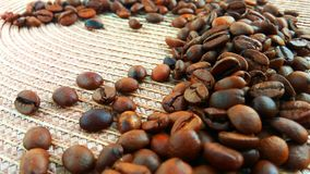 Roasted brown coffee beans on cloth background royalty free stock images