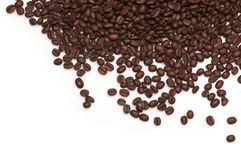 Roasted brown coffee beans isolated on white background. Brown coffee beans isolated on white background Royalty Free Stock Image