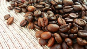 Roasted brown coffee beans on cloth background royalty free stock photo