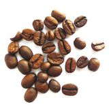 Roasted brown coffee beans and seeds isolated stock photos