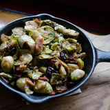 Roasted Brussel Sprouts. Cast iron pan, full of roasted Brussel sprouts and bacon Royalty Free Stock Image