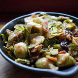 Roasted Brussel Sprouts. Cast iron pan, full of roasted Brussel sprouts and bacon Royalty Free Stock Images